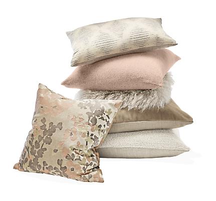 Detail stack of throw pillows in blush