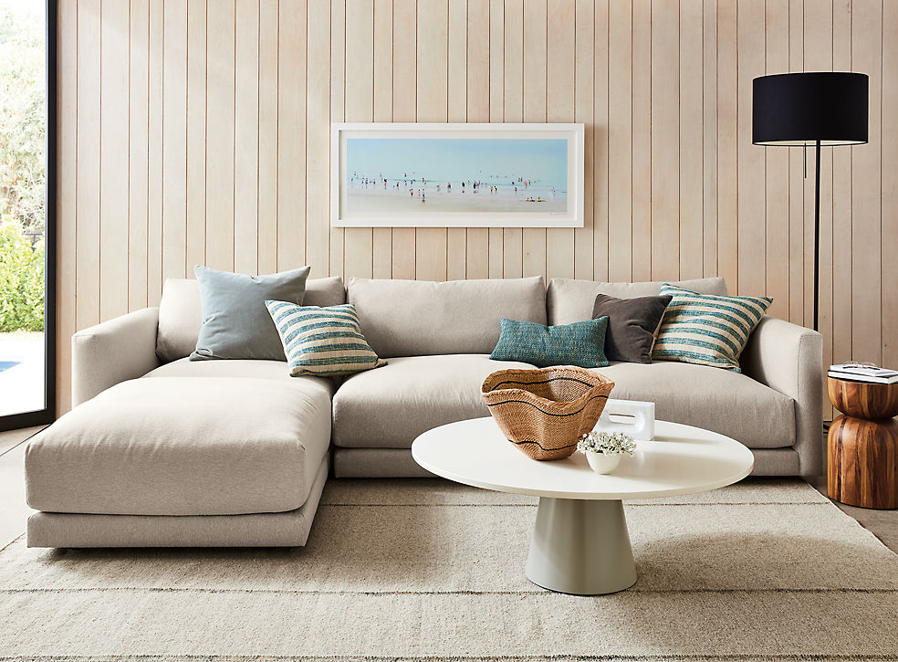 Living room with Clemens four piece modular sofa with ottoman in flint oatmeal