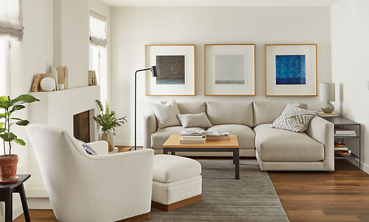 Detail of Clemens sofa with chaise in flint fabric in living room with Markus chair