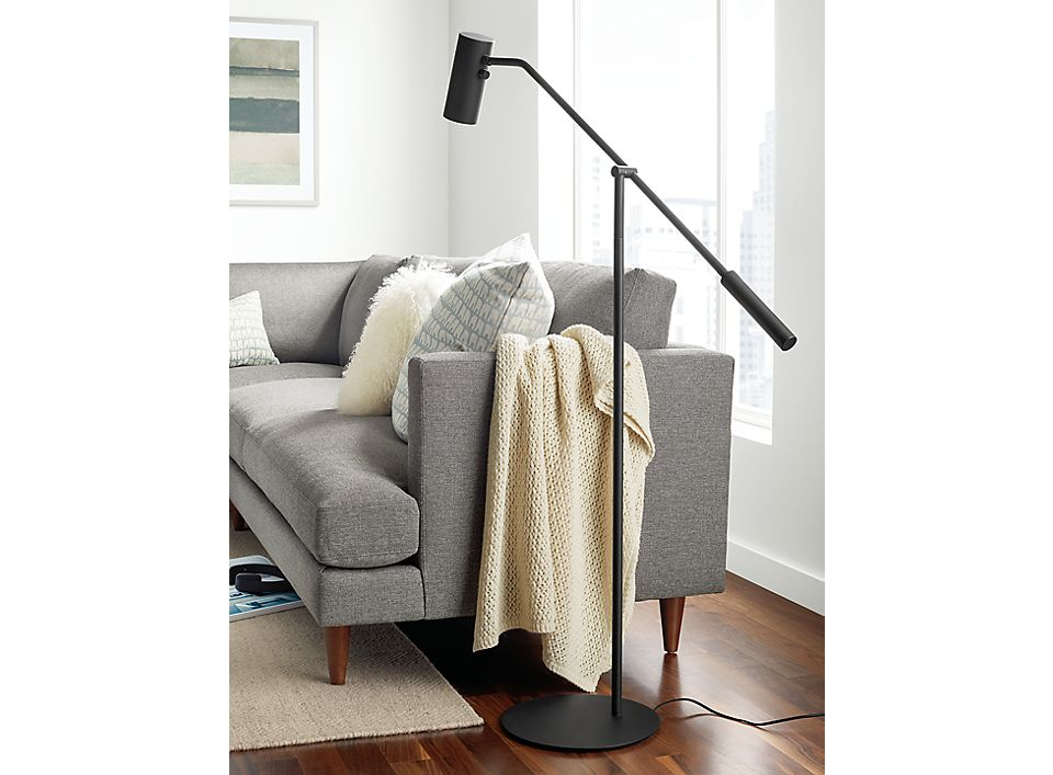 Detail view of Coda floor task lamp near sofa