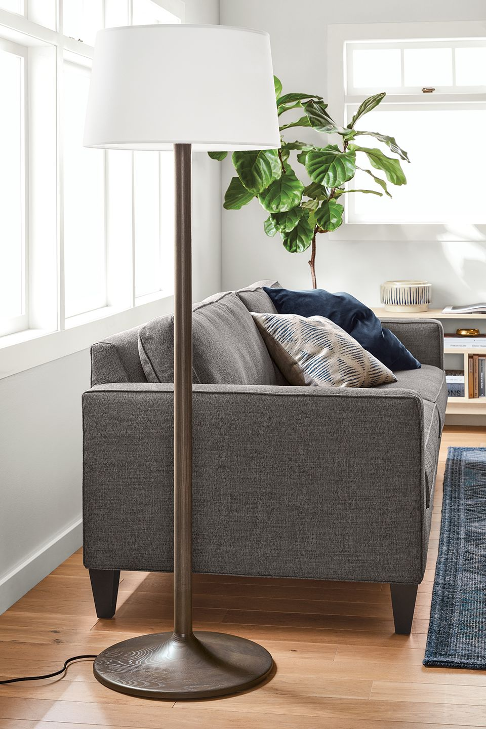 Detail of Connelly floor lamp near sofa