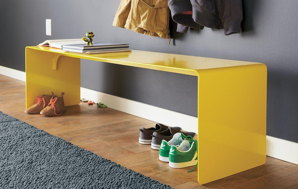 Detail of Cooper aluminum bench in yellow