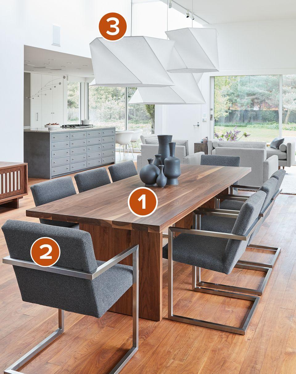 Corbett walnut dining table in modern dining room