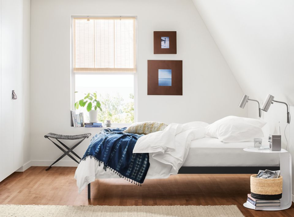Detail of Core platform bed in small minimal bedroom