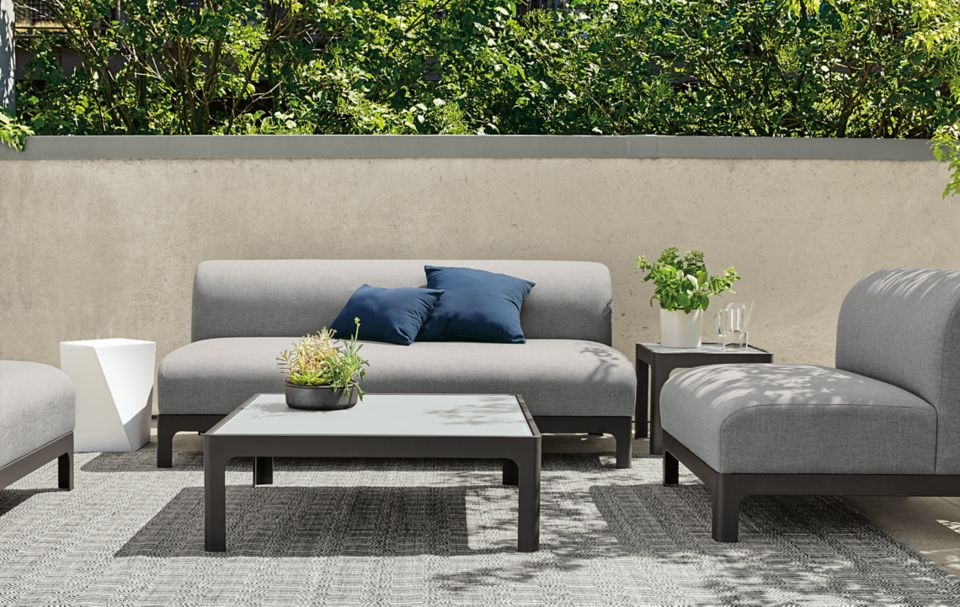 Modern Crescent outdoor sofas in grey fabric and table