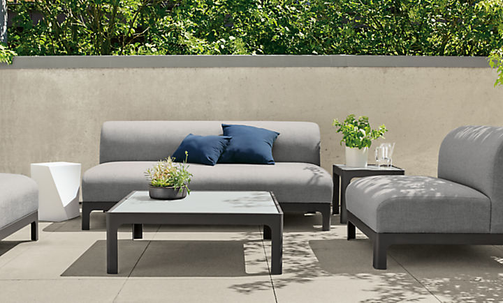 Crescent outdoor sofas in modern outdoor living space