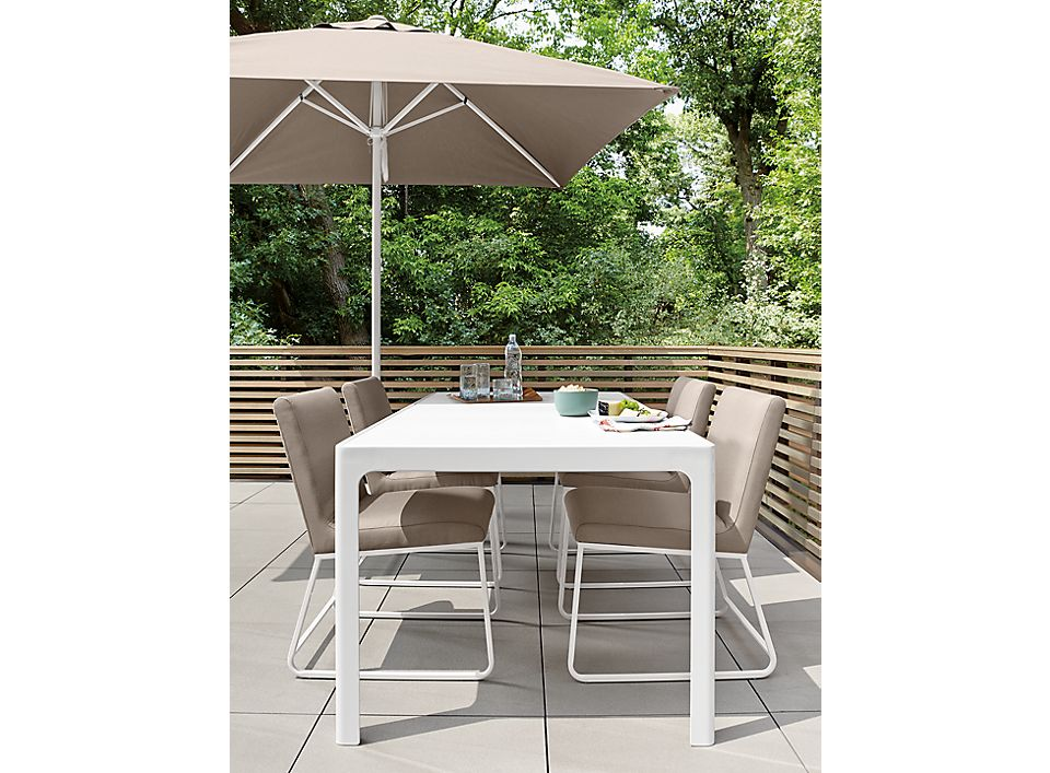Crescent outdoor dining furniture on patio