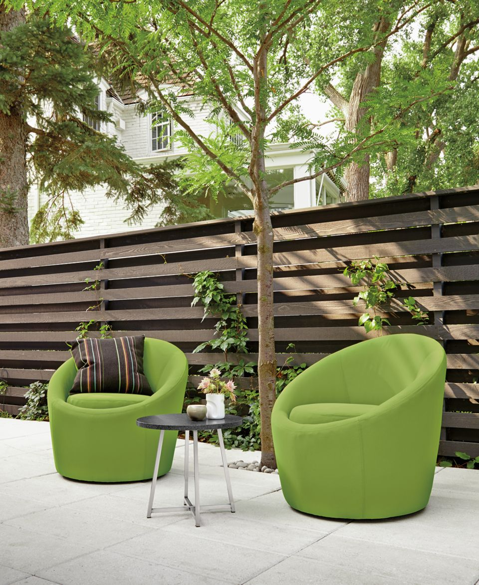 Two green Crest chairs on patio