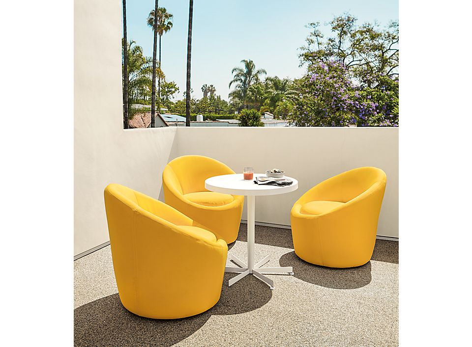 Detail of three Crescent outdoor swivel chairs