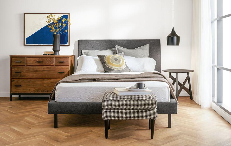 Detail of Ella bed in grey in modern bedroom