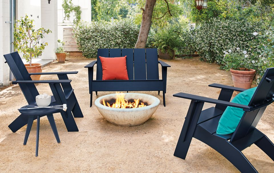 Detail of outdoor Emmet sofa and chairs in navy
