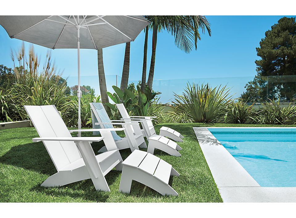 Three Emmet lounge chairs with umbrella