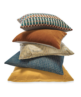 Stack of gold and blue throw pillows
