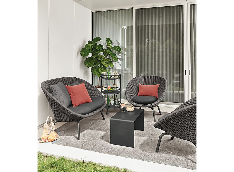 Detail of Flet outdoor sofa and two Flet outdoor chairs