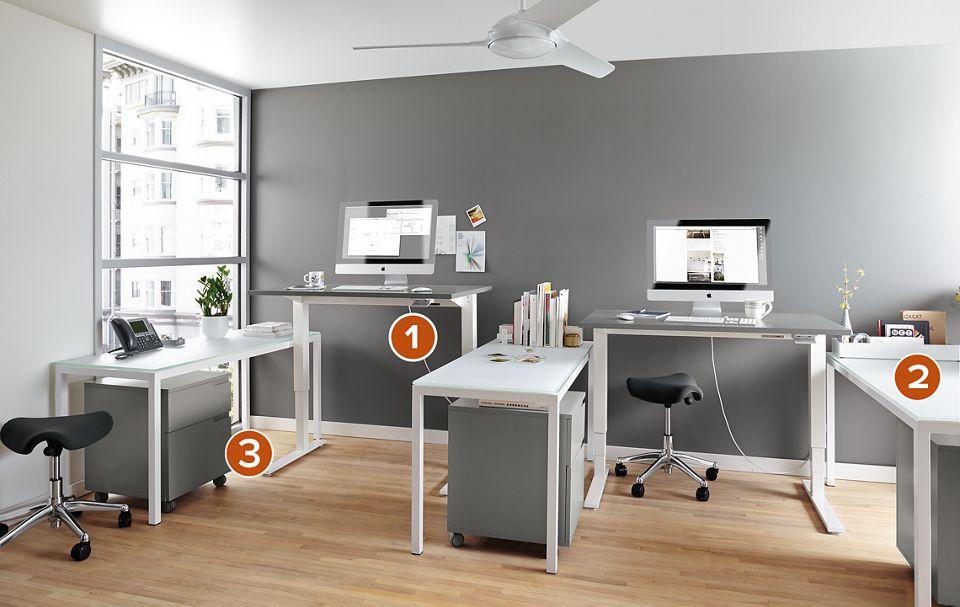 Float standing desks in modern office