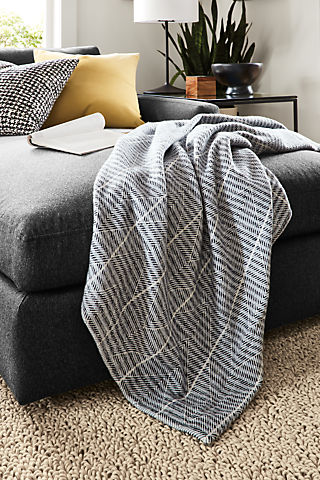 Living room with Gable throw blanket in navy