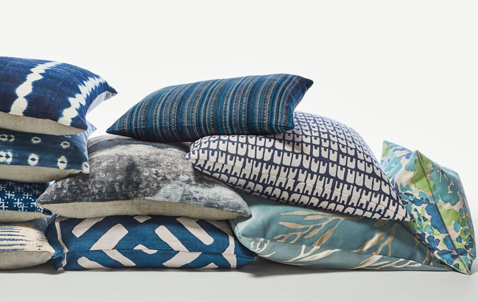 Collage of blue throw pillows