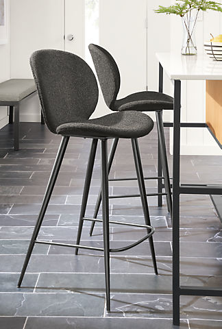 Detail of 2 Gwen counter stools in Radford Grey fabric set at Booker kitchen island