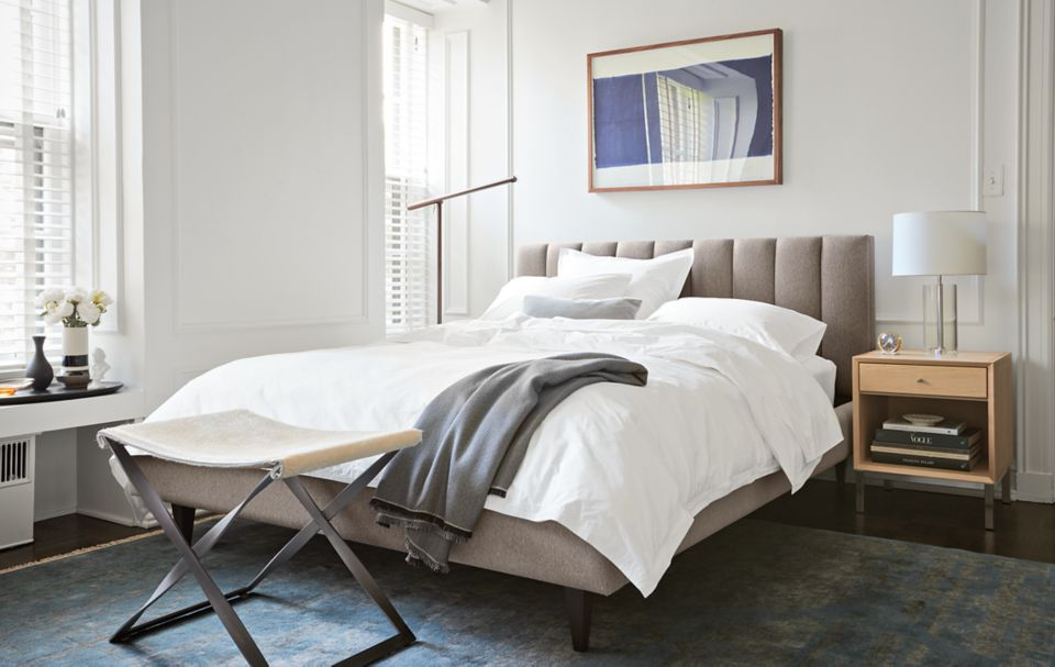 Hartley upholstered bed in condo bedroom