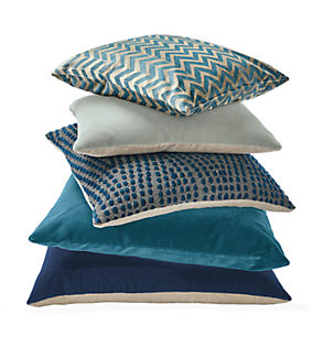 Detail stack of throw pillows in royal
