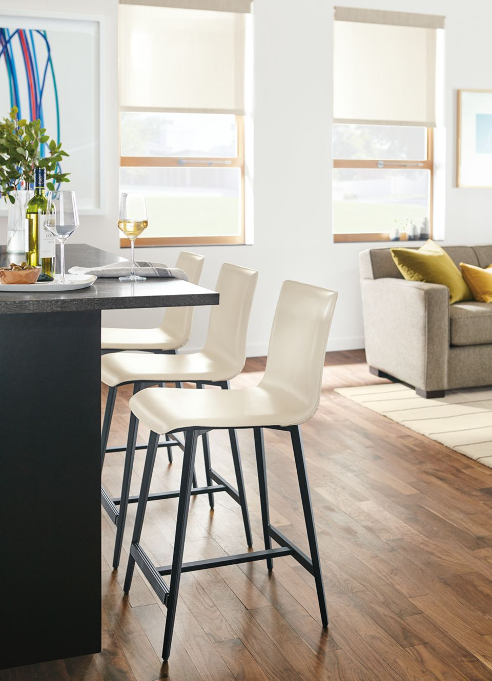 Three Hirsch leather modern kitchen stools