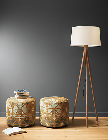 Detail of 2 Indira round ottomans in Saffron beside Lane floor lamp