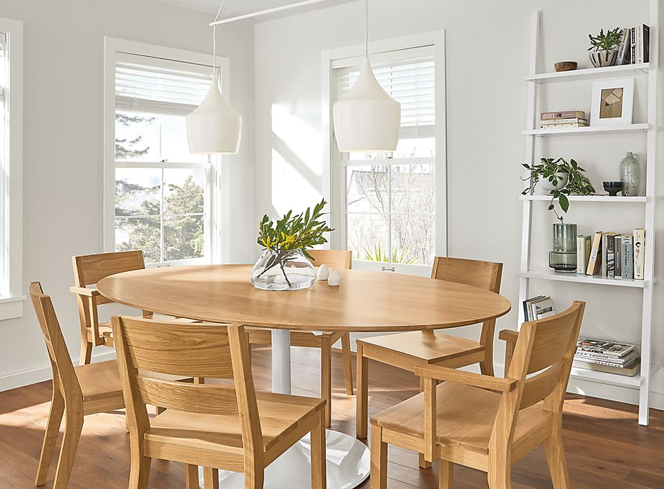 Detail of oval Julian table and Afton chairs in white oak