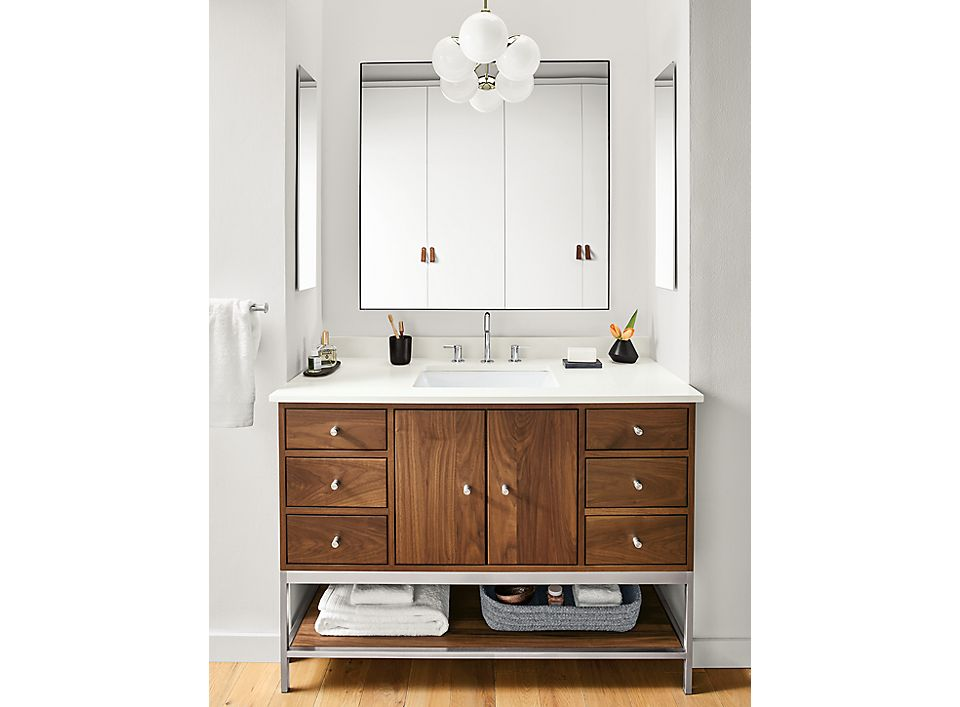 Detail of Linear bathroom vanity in walnut and stainless steel in bathroom