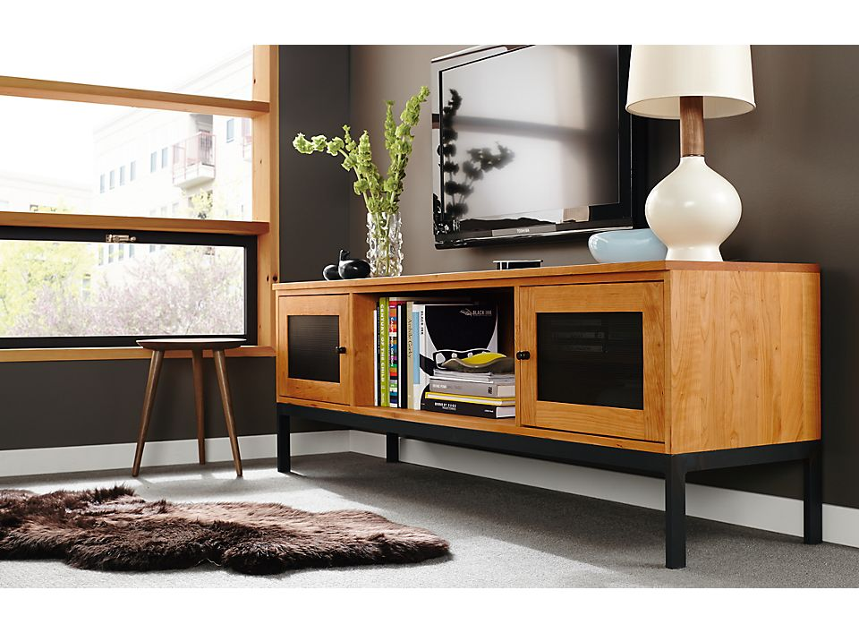 Detail of Linear media cabinet with steel base
