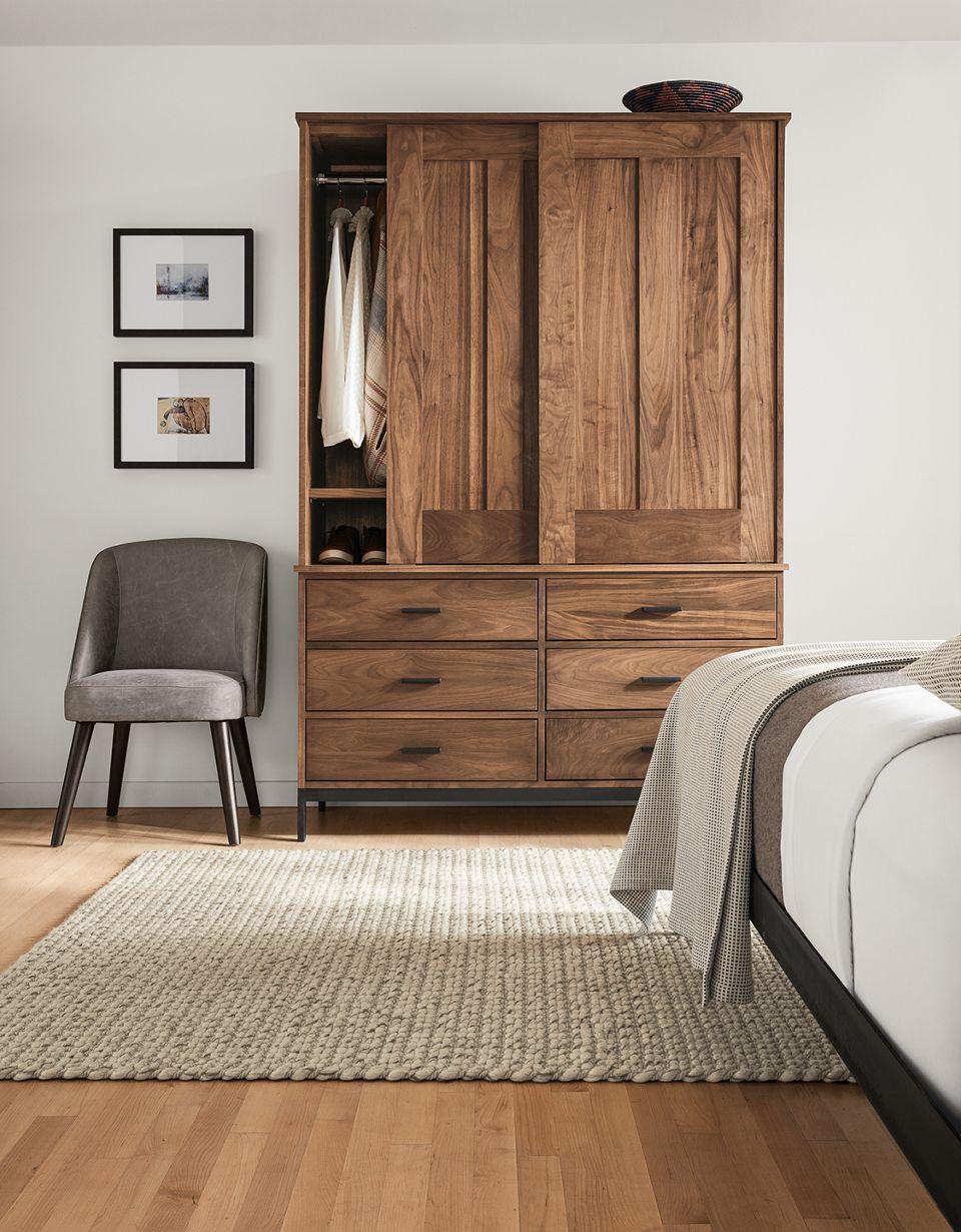 Detail of Linear walnut armoire