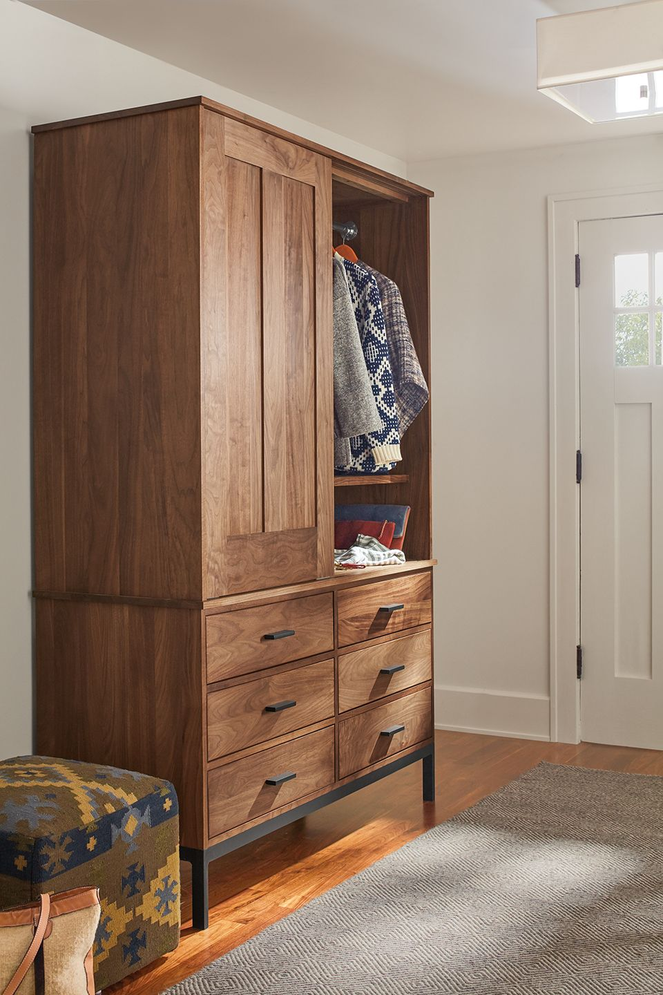 Side detail of Linear two-piece armoire