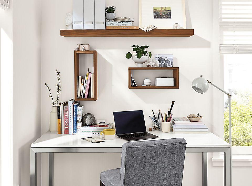Detail of Lloyd wall shelf in walnut above desk