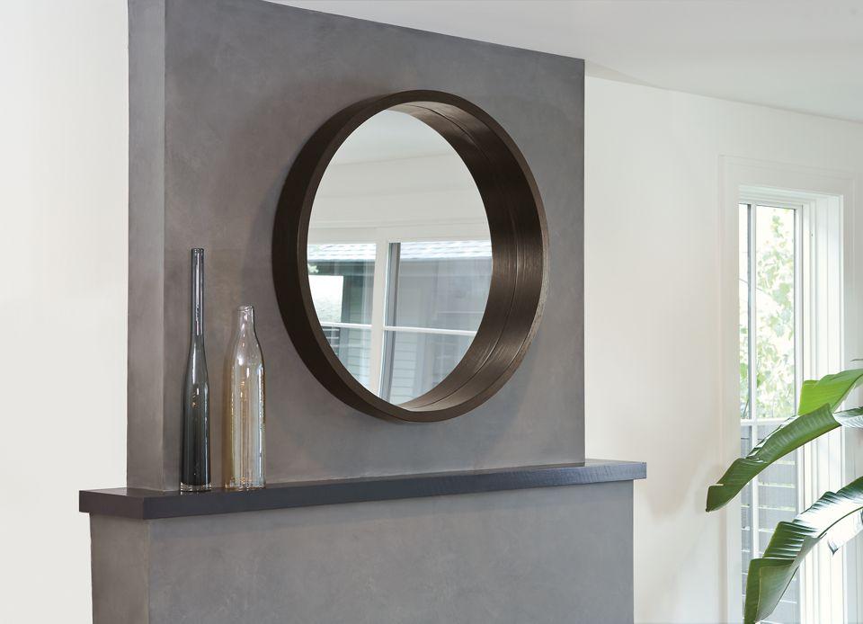 Detail of Loft round mirror above fireplace