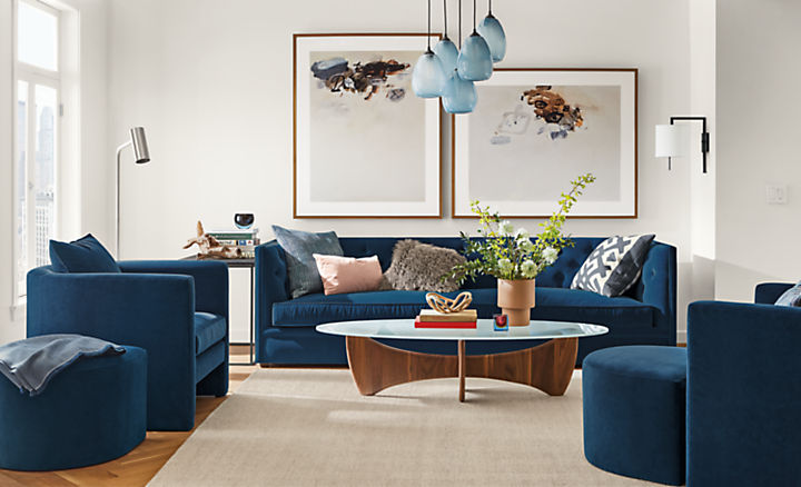 Detail of Macalester  sofa in banks denim in living room with 2 Silva chairs in banks denim