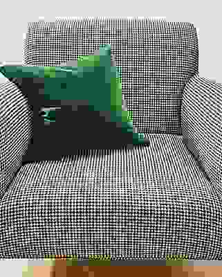 Detail of Matteo chair in Trend Salt fabric with green pillow