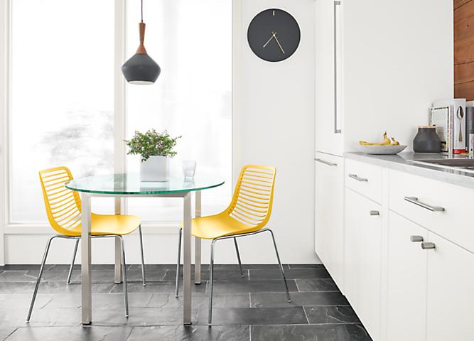 Detail of yellow Mini kitchen chairs