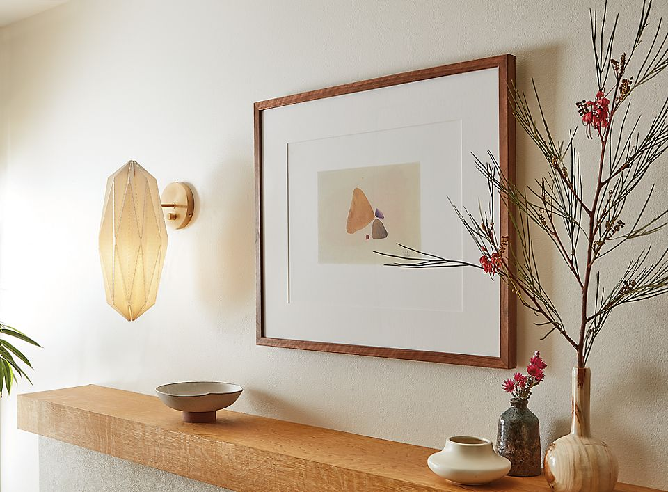 Living room with Orikata wall sconce in ivory linen