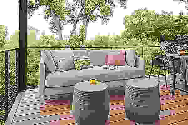 Detail of Palm outdoor sofa and Cusp round stools