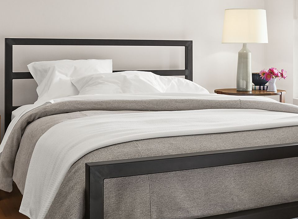 Side detail of Parsons natural steel bed