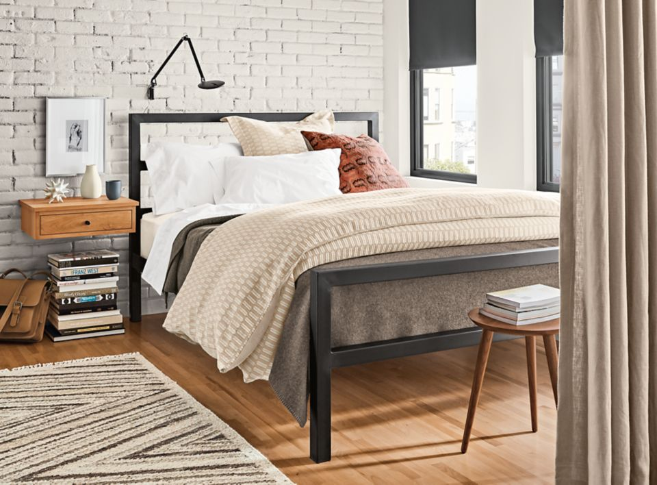 Detail of Parsons steel bed in modern bedroom