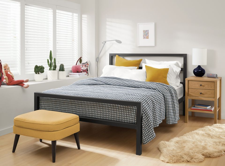 Detail of Parsons steel bed in small room