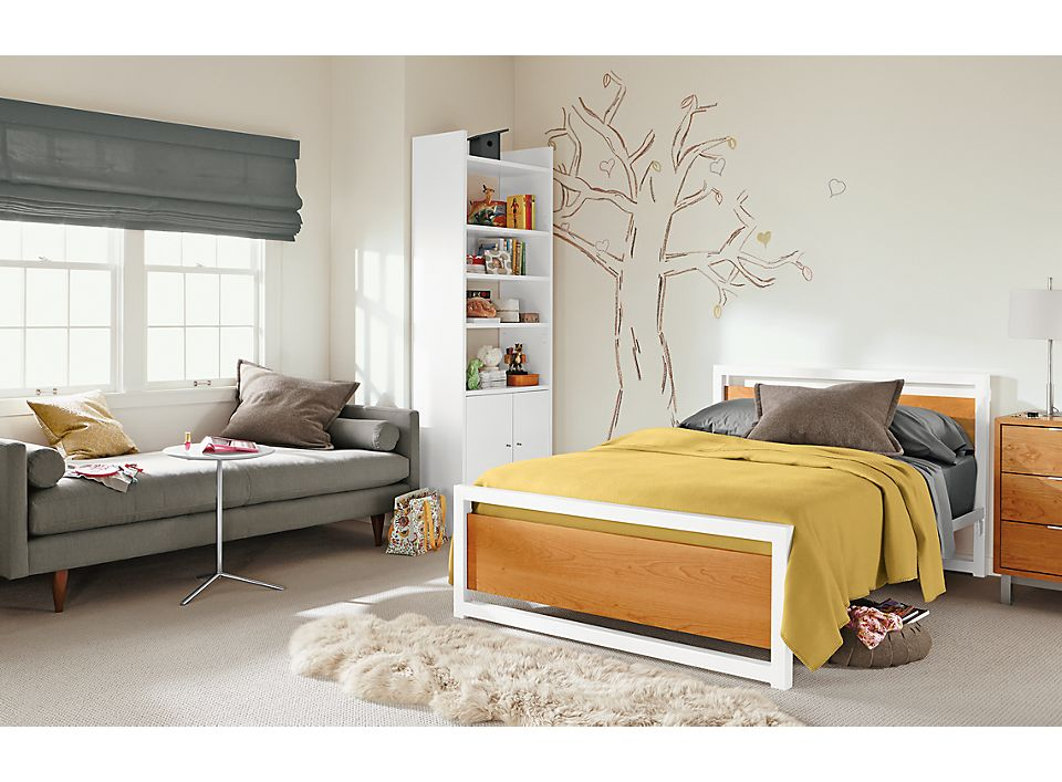 Detail of kids Piper full bed with cherry panels and white power coated steel base