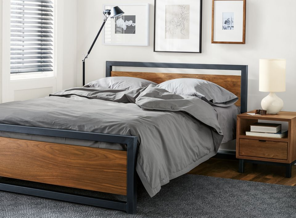 Detail of Piper queen bed with wood panels and natural steel frame