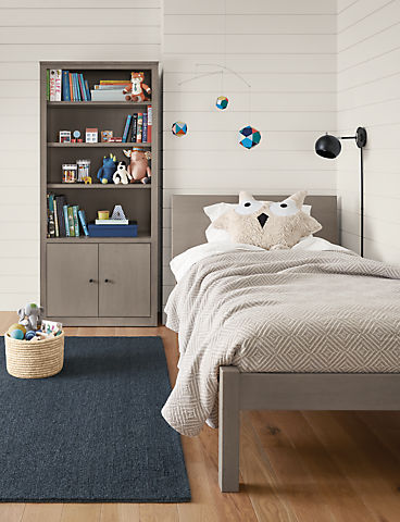 Detail of kids Pogo twin bed in maple with shell stain