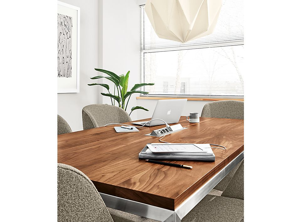 Detail of Portica conference table power ports, stainless steel base and walnut top