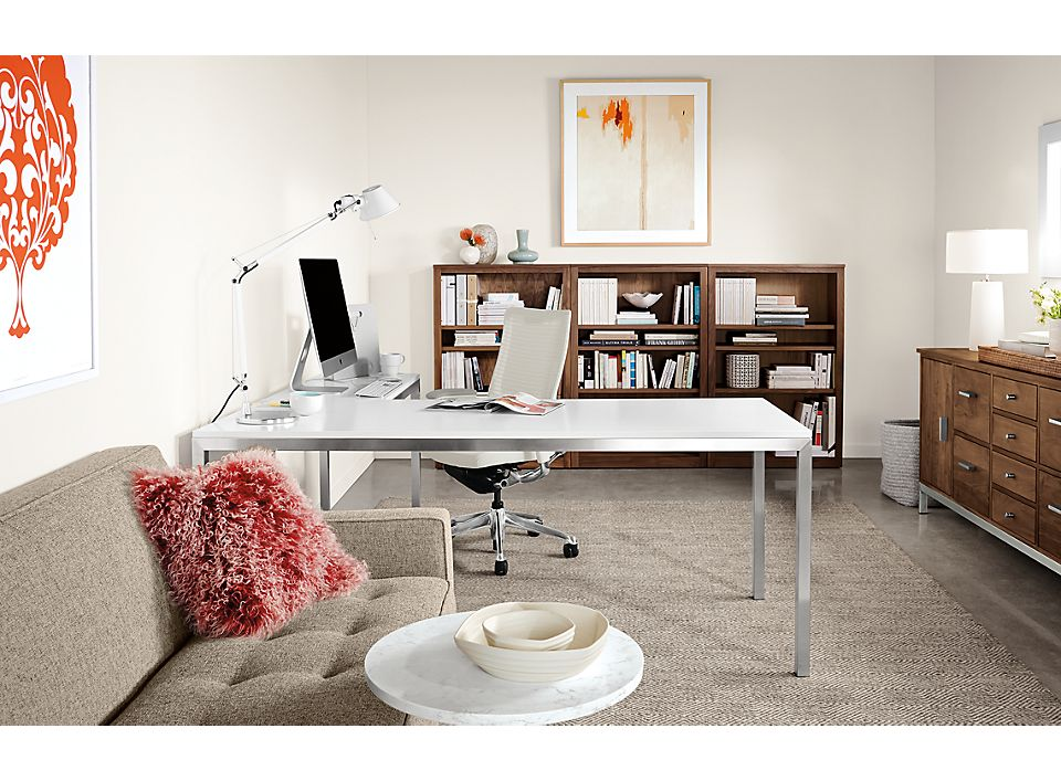 Detail of Portica L-shaped desk with stainless steel base and white MDF top