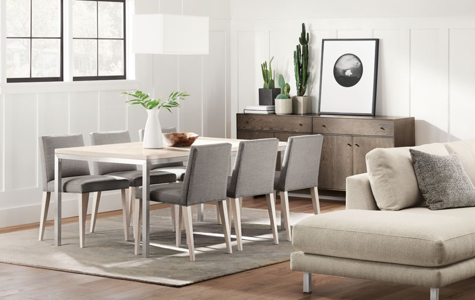 Detail of Portica dining table with stainless steel base and sand top