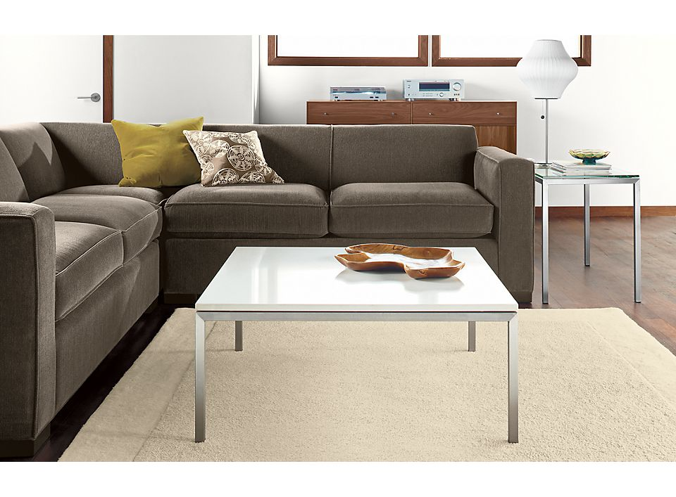 Detail of Portica square coffee table with stainless steel base and white quartz top