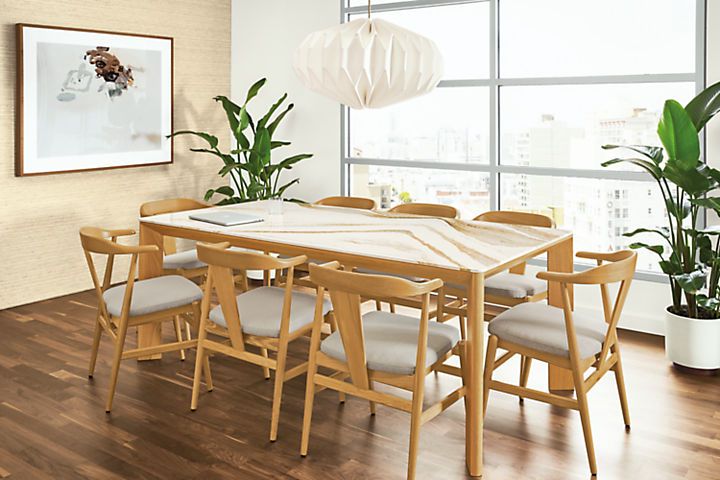 Detail of Pren table in white oak with Cambria Brittanica Gold top with Evan arm chairs