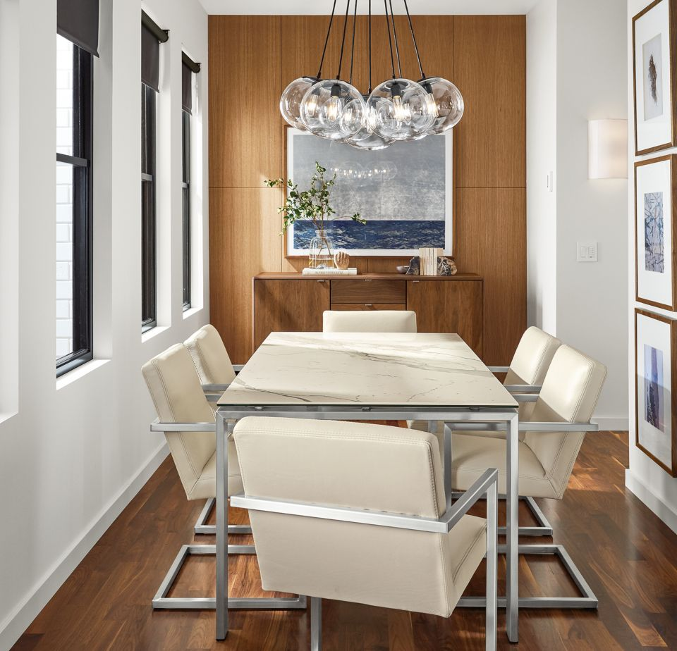 Detail of Rand dining table with stainless steel base and white marbled top